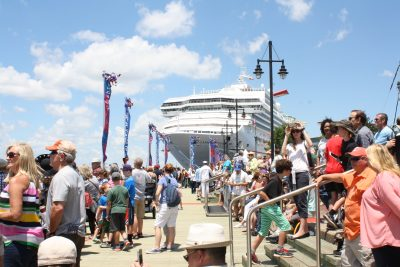 crowd gathering on the harbor